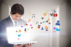 Businessman showing laptop with app icons Stock Photos