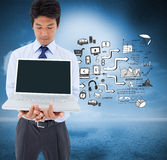 Businessman showing a laptop. Composite image of portrait of a young businessman showing a laptop royalty free stock photography