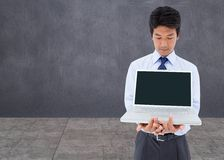Businessman showing a laptop Stock Images