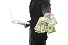 Businessman showing laptop and money Royalty Free Stock Photos