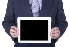 Businessman showing a laptop screen. Isolated over a white background royalty free stock images