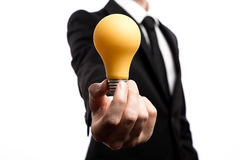 Businessman showing a lightbulb, inspiration concept Stock Images
