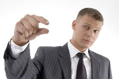 Businessman showing measuring gesture Stock Photography