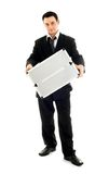 Businessman showing metal container Stock Images
