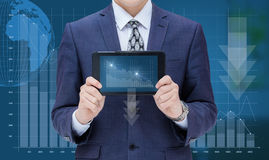 Businessman showing a mobile computer a schedule of loss. Stock Photography