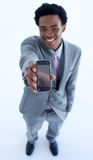 Businessman showing a mobile phone Stock Photo