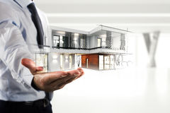 Businessman showing a modern office project stock photography