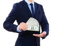 Businessman showing money Stock Images