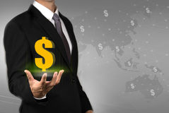 Businessman showing money transfer around the world. Royalty Free Stock Photos