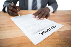 Businessman showing mortgage document Stock Image