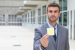 Businessman showing a note isolated.  Stock Images