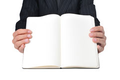 Businessman showing a notebook with blank pages Stock Photo