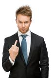 Businessman showing obscene gesture. Half-length portrait of businessman showing obscene gesture, isolated on white. Concept of stress and aggression Stock Photo