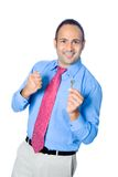 Businessman showing off a key Royalty Free Stock Images