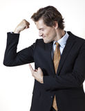 Businessman showing off mucsles Stock Photography