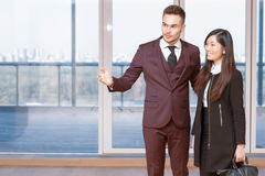 Businessman showing the office to his partner Stock Images