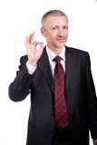 Businessman showing OK gesture Royalty Free Stock Photos