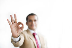 Businessman showing ok hand sign for perfection Stock Photography