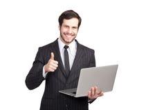 Businessman showing ok with a laptop. Elegant man showing ok sign with a laptop in his hand, isolated stock image