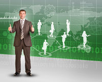 Businessman showing ok and looking at camera Royalty Free Stock Images