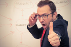 Businessman showing ok sigh with his thumb. royalty free stock photo