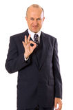 Businessman showing ok sign. Isolated on white Stock Images