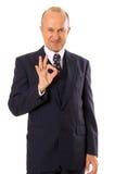 Businessman showing ok sign Stock Images