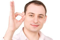Businessman showing ok sign Stock Images
