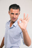 Businessman showing ok sign with fingers Royalty Free Stock Photos