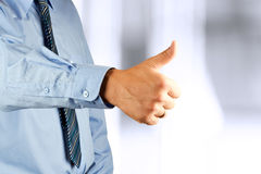 Businessman showing OK sign with his thumb up. Royalty Free Stock Images