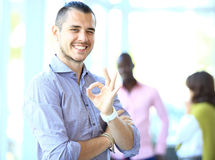 Businessman showing OK sign with his thumb up. Stock Photos