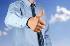 Businessman showing OK sign with his thumb up. Stock Photography