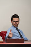 Businessman Showing Ok Sign With His Thumb Up Royalty Free Stock Photography