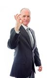 Businessman showing ok sign Stock Photo