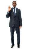Businessman  showing okay sign Stock Images