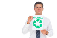 Businessman showing a paper with environmental awareness sign Stock Photo