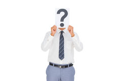 Businessman showing a paper with a question mark Stock Photos