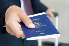 Businessman showing passport Royalty Free Stock Image