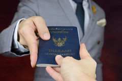 Businessman showing passport, travel aboard, business trip Stock Photos