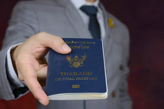 Businessman showing passport, travel aboard, business trip Stock Photo