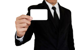 Businessman showing pasteboard. Businessman in black suit showing pasteboard with right hand on white background Stock Photos
