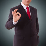 Businessman showing perfect gesture. Hand sign excellent, good, great, okay, yes. Stock Photography