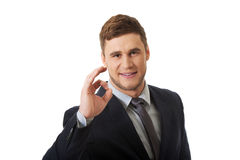 Businessman showing perfect sign. Royalty Free Stock Image