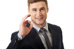 Businessman showing perfect sign. Royalty Free Stock Photography
