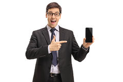 Businessman showing a phone and pointing Stock Photos
