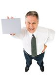 Businessman showing placard Royalty Free Stock Photo