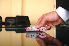 Businessman showing playing cards Royalty Free Stock Images