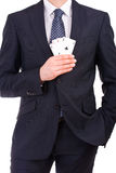 Businessman showing playing cards. Stock Images