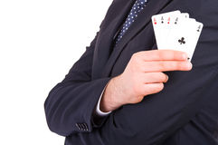 Businessman showing playing cards. Stock Image