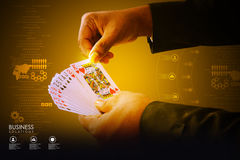 Businessman showing playing cards Royalty Free Stock Photography